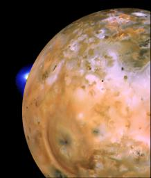 NASA's Voyager 1 image of Io showing active plume of Loki on limb. Heart-shaped feature southeast of Loki consists of fallout deposits from active plume Pele.