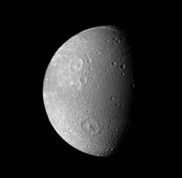 Many impact craters -- the record of the collision of cosmic debris -- are shown in this mosaic from NASA's Voyager 1 of Saturn's moon Dione.
