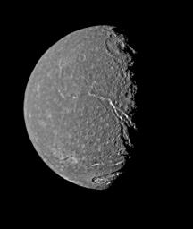 On Jan. 24, 1986, NASA's Voyager 2 returned the highest-resolution picture of Titania, Uranus' largest satellite. Abundant impact craters of many sizes pockmark the ancient surface; most prominent features are fault valleys that stretch across Titania.