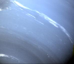 This image of Neptune was taken by NASA's Voyager 2's wide-angle camera; small trails of similar clouds trending east to west and large scale structure east of the Great Dark Spot all suggest that waves are present in the atmosphere and play a large role