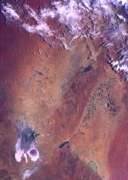 This color image of the Simpson Desert in Australia was obtained by NASA's Galileo spacecraft at about 2:30 p.m. PST, Dec. 8, 1990, at a range of more than 35,000 miles.