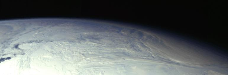 This color picture of the limb of the Earth, looking north past Antarctica, is a mosaic of 11 images taken during a ten-minute period near 5:45 p.m. PST Dec. 8, 1990, by NASA�s Galileo's imaging system.