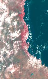 This false color image of the Eastern Coast of Australia was obtained by NASA's Galileo spacecraft at about 3:00 p.m. PST, Dec. 8, 1990, at a range of more than 35,000 miles.