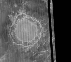 NASA's Magellan image mosaic shows the largest impact crater known to exist on Venus at this point in the Magellan mission. The crater is located north of Aphrodite Terra and east of Eistla Regio and was imaged during orbit 804 on November 12, 1990.
