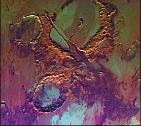 Tharsis-centered volcanic and tectonic activity resulted in the formation of radial grabens of Memnonia Fossae, which cut materials of the ancient cratered highlands and the relatively young, highland-embaying lava flows as seen by NASA's Viking Orbiter 2