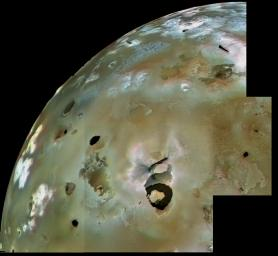A huge area of Io's volcanic plains is shown in this archival image mosaic from NASA's Voyager 1. Numerous volcanic calderas and lava flows are visible here. Loki Patera, an active lava lake, is the large shield-shaped black feature.
