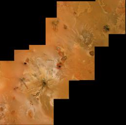 Io's volcanic plains are shown in this image mosaic from NASA's Voyager 1. Also visible are numerous volcanic calderas and lava flows. Ra Patera with its multihued lava flows is below and right of the mosaic's center.