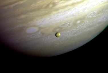 This photograph of the southern hemisphere of Jupiter was obtained by NASA's Voyager 2 on June 25, 1979. Seen in front of the turbulent clouds of the planet is Io, the innermost of the large Galilean satellites of Jupiter.