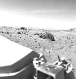This Mars view looks northeast from NASA's Viking 1 and completes the 360 panorama of the landing site. A layer of haze can be seen in the Martian sky. Large dark boulders dominate the scene.