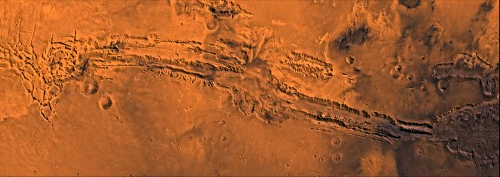 Valles Marineris, the great canyon of Mars. This scene shows the entire canyon system, extending from Noctis Labyrinthus, the arcuate system of graben to the west, to the chaotic terrain to the east, as seen by NASA's Viking spacecraft.