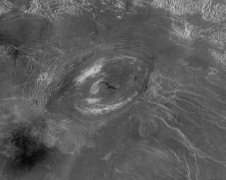 This image from NASA's Magellan spacecraft reveals Sacajawea Patera, a large, elongate caldera located in Western Ishtar Terra on the smooth plateau of Lakshmi Planum.