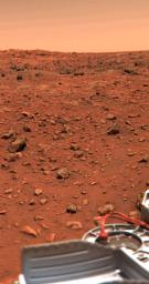 NASA's Viking 1 obtained this color picture of the Martian surface and sky on July 24, 1997; part of the spacecraft's gray structure in the foreground.