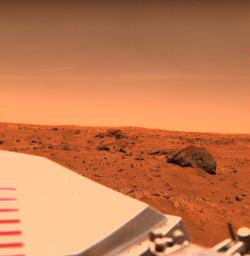 Near NASA's Viking 1 Lander on the Chryse Plains of Mars, 'Big Joe' stands a silent vigil.