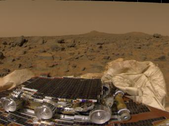 This is one of the first pictures taken by the camera on NASA's Mars Pathfinder lander shortly after its touchdown at 10:07 AM Pacific Daylight Time on July 4, 1997. The small rover, named Sojourner, is seen in the foreground.