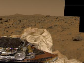 NASA's Mars Pathfinder took this image of surrounding terrain in the mid-morning on Mars (2:30 PM Pacific Daylight Time) in 1997. Part of the small rover, Sojourner, is visible on the left side of the picture.