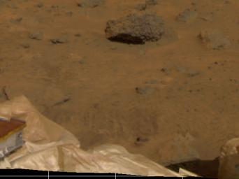 Several objects were imaged by NASA's Mars Pathfinder (IMP) during the spacecraft's first day on Mars, July 4, 1997. Portions of the deflated airbags, part of one the lander's petals, soil, and several rocks are visible.