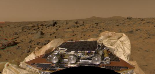 NASA's Sojourner rover and undeployed ramps onboard the Mars Pathfinder spacecraft can be seen in this image, by the Imager for Mars Pathfinder (IMP) on July 4, 1997 (Sol 1).