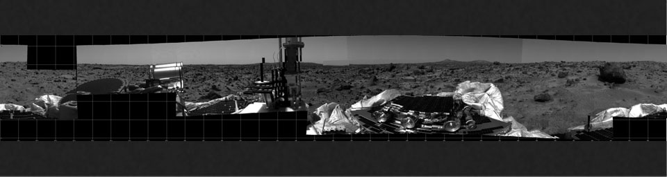 This photomosaic was taken by the Imager for Mars Pathfinder (IMP) camera on July 4, 1997 between 4:00-4:30 p.m. PDT. The foreground is dominated by the lander, newly renamed the Sagan Memorial Station after the late Dr. Carl Sagan.