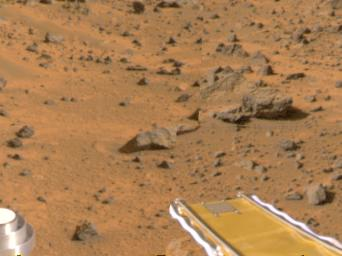 Mars Pathfinder's forward rover ramp can be seen successfully unfurled in this color image, taken at the end of July 6, 1997 by the NASA's Imager for Mars Pathfinder (IMP). he square at the end of the ramp is one of the spacecraft's magnetic targets.
