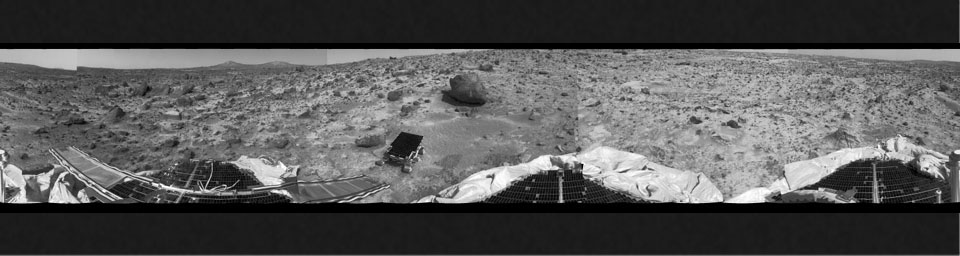 This 360 degree 'monster' panorama was taken by NASA's Mars Pathfinder (IMP) on Sol 3. All three petals, the perimeter of the deflated airbags, deployed rover Sojourner, forward and backward ramps and prominent surface features are visible.
