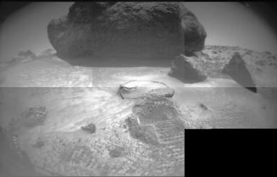 Taken from NASA's rover Sojourner's front stereo camera, this image features the large rock 'Yogi' and hole dug by the front wheel of the rover into the Martian soil.