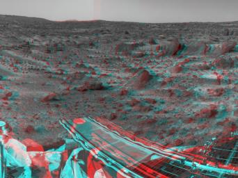 NASA's Mars Pathfinder's forward rover ramp can be seen successfully unfurled in this image, taken in stereo by the Imager camera. 3-D glasses are necessary to identify surface detail.
