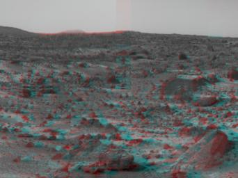 NASA's Mars Pathfinder's forward rover ramp can be seen successfully unfurled in this image, taken in stereo by the Imager camera. The large rock dubbed 'Wedge' is at lower right. 3D glasses are necessary to identify surface detail.