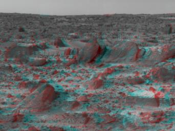 Many prominent rocks near the Sagan Memorial Station are featured in this image from NASA's Mars Pathfinder. 'Shark', 'Half-Dome', and 'Pumpkin' are at center 3D glasses are necessary to identify surface detail.