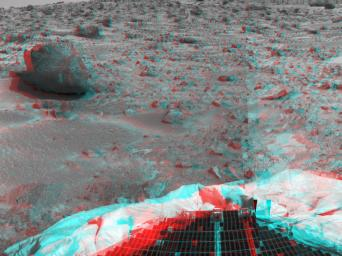 This image from NASA's Mars Pathfinder shows the large rock nicknamed 'Yogi.' Portions of a petal and deflated airbag are in the foreground. 3D glasses are necessary to identify surface detail.