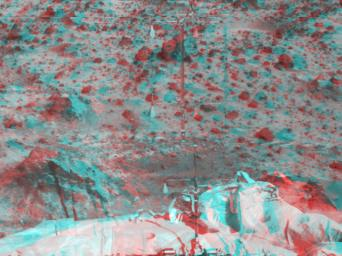 The Atmospheric Structure Instrument/Meteorology Package (ASI/MET) is the mast and windsocks at the center of this stereo image from NASA's Mars Pathfinder. 3D glasses are necessary to identify surface detail.