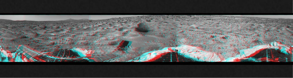 This 360-degree panorama was taken by NASA's Mars Pathfinder. Three petals and the perimeter of the deflated airbags are seen in the foreground. 3D glasses are necessary to identify surface detail.