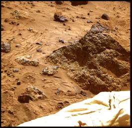 The 'Mini Matterhorn' is a 3/4 meter rock immediately east-southeast of NASA's Mars Pathfinder lander. This image was produced by combining the 'Super pan' frames from the IMP camera. Sol 1 began on July 4, 1997.