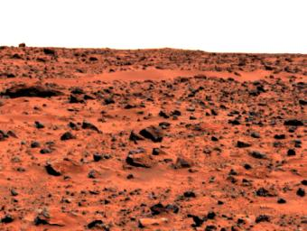 This enhanced color image of the Pathfinder landing site shows the eastern horizon. The elongated, reddish, low contrast region in the distance is 'Roadrunner Flats.' This image was taken by by NASA's Mars Pathfinder (MPF).