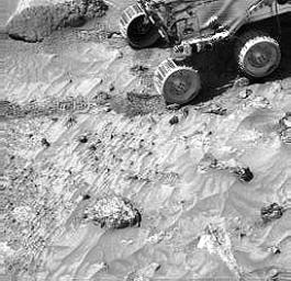 Pebbles are seen in lander images, along with cobbles. For example, this image taken by NASA's Imager for Mars Pathfinder (IMP) shows the same pebbles that were visible in the Sojourner rover image of the