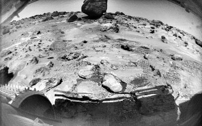 This NASA's Sojourner image, taken on Sol 70, shows rocks and rover-disturbed soil. Cleats on Sojourner's left front wheel are seen at lower left. The large rock in the distance is 'Yogi.'