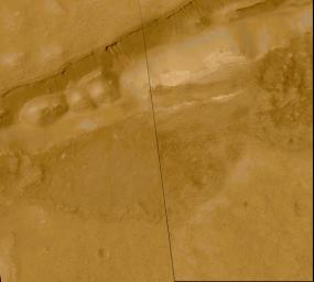 Evidence for Recent Liquid Water on Mars: Gullies in Sirenum Fossae Trough
