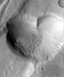 NASA's Mars Global Surveyor captured this 'valentine' from Mars in 1999. The graben, pit, and lava flow are located on the east flank of the Alba Patera volcano in northern Tharsis.