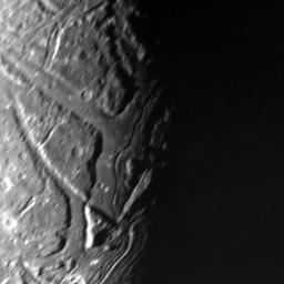 This NASA Voyager 2 view of Uranus' moon Ariel's terminator shows a complex array of transecting valleys with super-imposed impact craters.