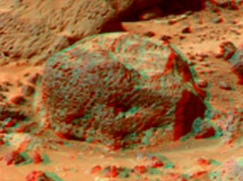 This anaglyph view of 'Stimpy', in the 'Rock Garden,' was produced by NASA's Mars Pathfinder's Imager camera. 3D glasses are necessary to identify surface detail.