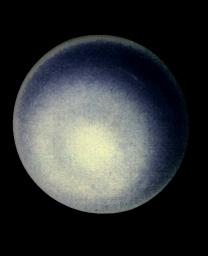 This computer enhancement of a NASA Voyager 2 image, emphasizes the high-level haze in Uranus' upper atmosphere. Clouds are obscured by the overlying atmosphere.