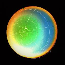 A latitude-longitude grid superimposed on this false color image obtained by NASA's Voyager 2 in 1986 shows that Uranus' atmosphere circulates in the same direction as the planet rotates.