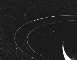 In Neptune's outermost ring, 39,000 miles out, material mysteriously clumps into three arcs. Voyager 2 acquired this image as it encountered Neptune in August of 1989.