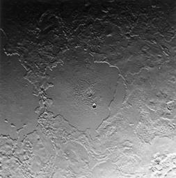 Part of the complex geologic history of icy Triton, Neptune's largest satellite, is shown in this NASA Voyager 2 photo. The photo was received as part of a Triton-mapping sequence in 1989.