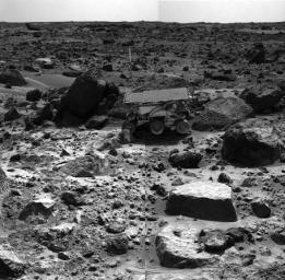 This is the left image of a stereo image pair showing NASA's Sojourner rover in the middle of the afternoon on Sol 66 (September 9). The rover has backed away from the rock 'Moe' after measuring its composition with the Alpha Proton X-Ray spectrometer.