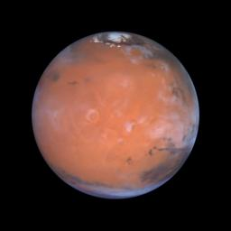 Astronomers using NASA's Hubble Space Telescope took this view of Mars taking advantage of the space-based observatory's close approach to Mars, centering on the region known as Tharsis, home of the largest volcanoes in the solar system.