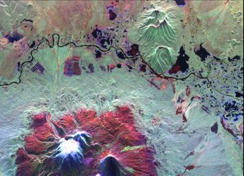 This is an image of the Kliuchevskoi volcano, Kamchatka, Russia, which began to erupt on September 30, 1994. Kliuchevskoi is the bright white peak surrounded by red slopes in the lower left portion of the image.