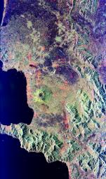 Mt. Vesuvius, one of the best known volcanoes in the world primarily for the eruption that buried the Roman city of Pompeii, is shown in the center of this radar image.
