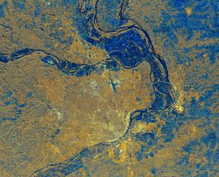 This is a spaceborne radar image of the area surrounding St. Louis, Missouri, where the Mississippi and Missouri Rivers come together. The city of St. Louis is the bright gold area within a bend in the Mississippi River at the lower center of the image.