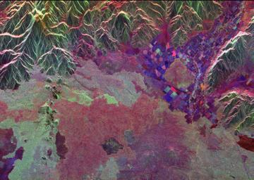 Ancient lava flows dating back 2,000 to 15,000 years are shown in light green and red on the left side of this space radar image of the Craters of the Moon National Monument area in Idaho.