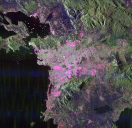 This space radar image of Athens, Greece, shows the sprawling, modern development of this ancient capital city. Densely populated urban areas appear in shades of pink and light green.